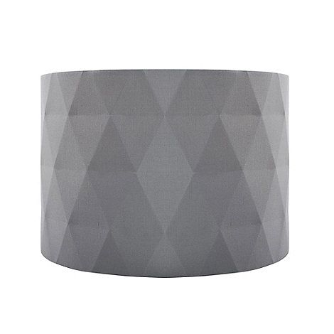 This shade is a contemporary lighting accessory that will complement a modern interior. Ideal for adding a warm glowing ambience to the bedroom or living room, its stylish design is finished in grey and features a pleated diamond pattern.