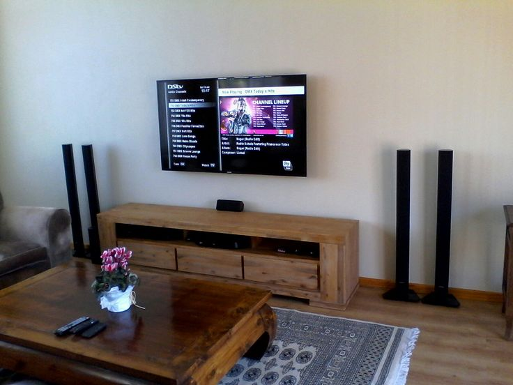 Tv wall mounted. Dstv Explora decoder  installed. Home theatre system installed