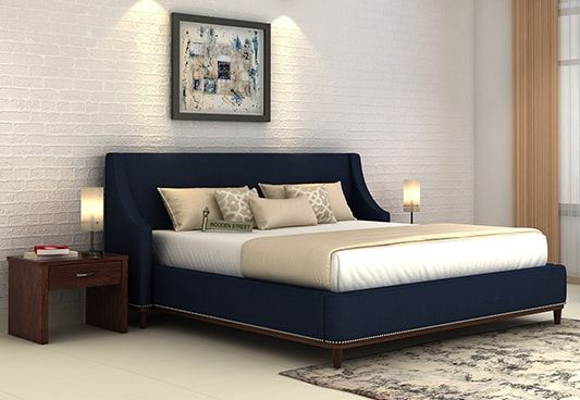 The Ross Upholstered Bed With Storage in Indigo Ink at Wooden Street is an amazing King Size Fabric Bed. It makes enticing appearance and uplifts the decor of the area. Buy upholstered beds online #Bangalore #Pune #NaviMumbai #Delhi