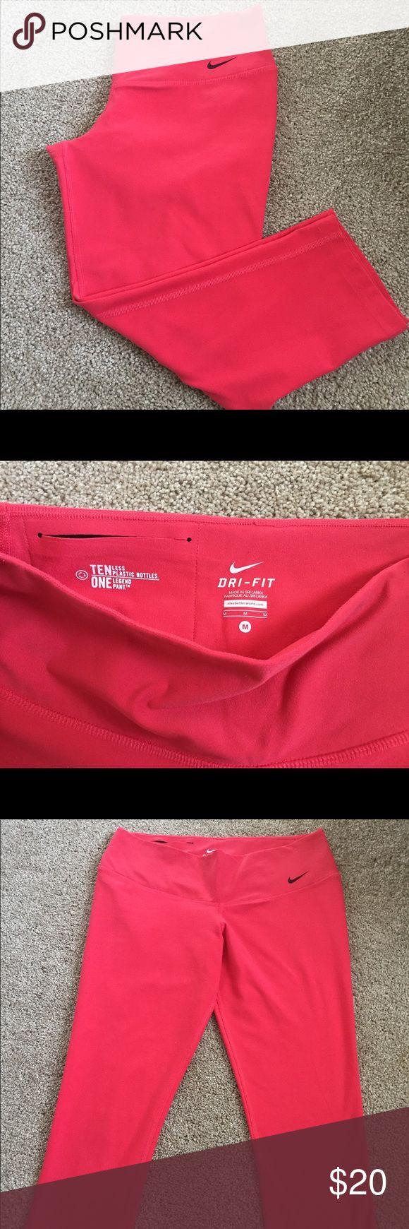 Nike Dri-Fit Capri Pants Bright pink capris-length workout pants. Tight fitting. Excellent used condition! Nike Pants Capris