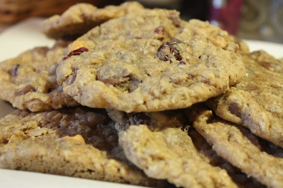 The Best Oatmeal Cookies--these are in my oven baking as I type and they are delicious! The changes I made were--raisins instead of cranberries (that's what I had on hand), a good 1 cup of both choc chips & butterscotch chips, no toffee chips (didn't have them) and 1 cup coconut. I didn't freeze the dough and I used a med cookie scoop and dropped them and they baked up fabulous! Next time I think I will use less sugar by at least a 1/2 cup, because the add ins add a lot of sweetness. Very good!: Home And Family, Best Oatmeal Cookies, Recipe, Redheaded Hostess, Chewy Cookies, Families, Homes