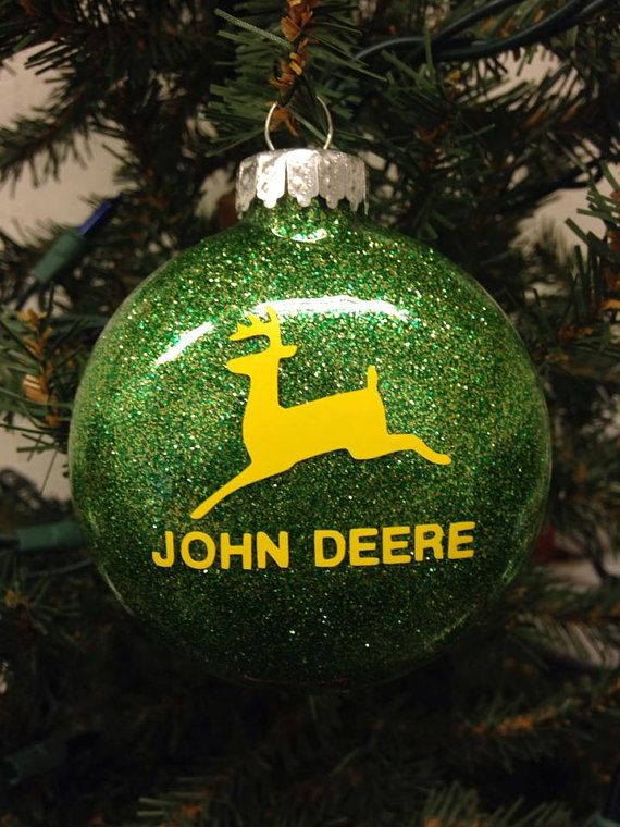 """Designed by Bri's Crafts & Things, these fun holiday ornaments are thin, round bulbs filled with lots of sparkle and vinyled with your favorite farm logo - John Deere. Ornaments measure about 3"""" in di"""