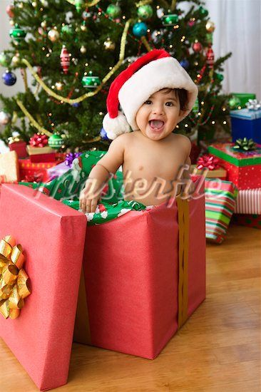 Photo idea - baby in present box by the tree