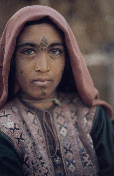 Afghan woman with tattooed beauty marks.