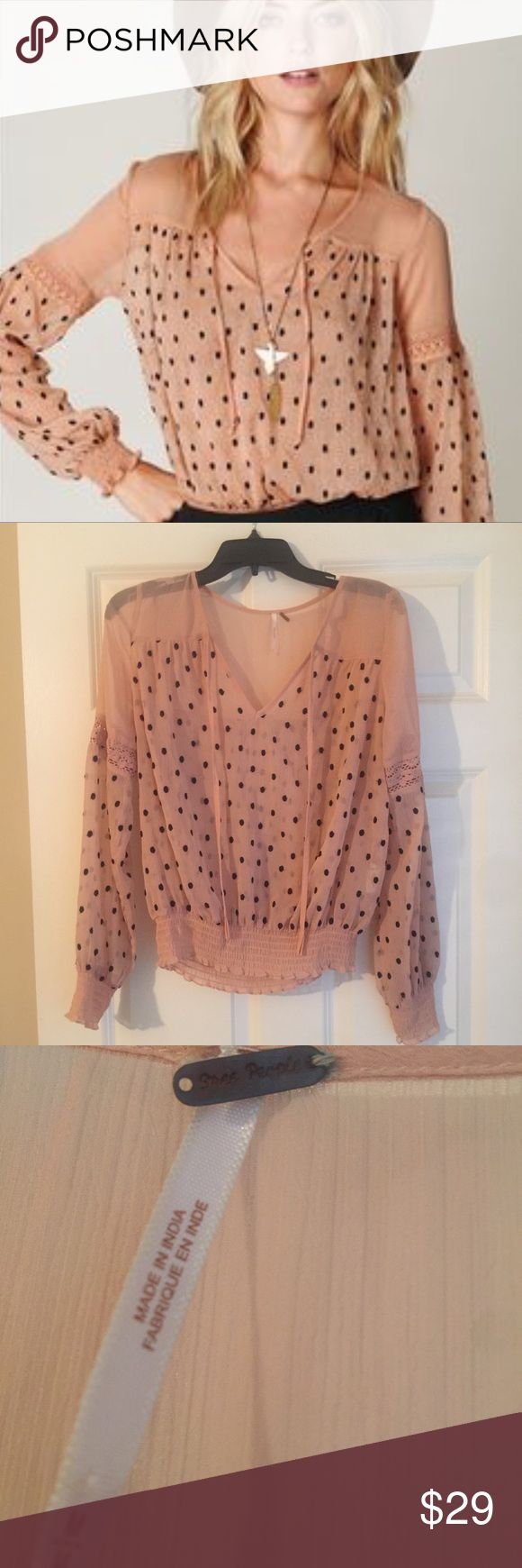 ✨ 1 DAY SALE ✨ Free People Boho Polka Dot Blouse In excellent used condition. Perfect for spring. It's sheer so I recommend wearing a cami underneath or you could even wear this top to the beach with a bikini underneath. There are a couple polka dots with extra threads, see photo. Free People Tops