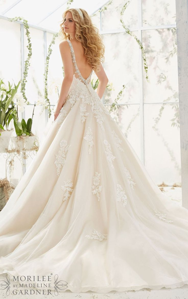 Designer: MoriLee Style: 2811 Available at Bliss Bridal in Wisconsin