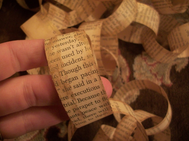 I string popcorn and make paper chains for the Christmas tree. This year, I am making my chain out of old book pages. :)