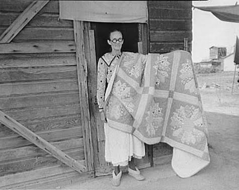 GRANDMOTHER WITH HER HAND MADE QUILT -- 1936