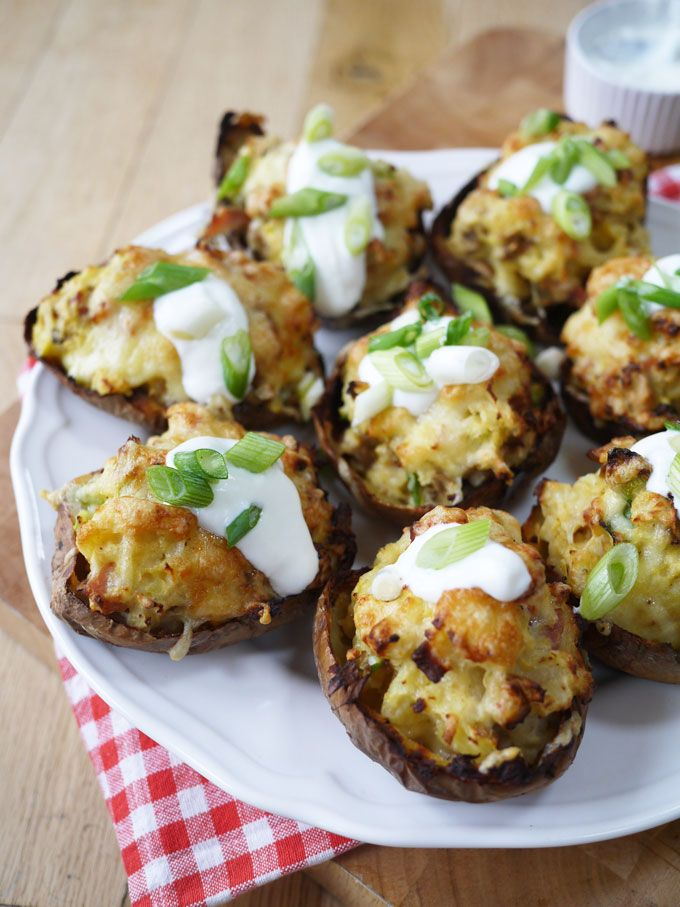 Skinny LOADED Cheese and Bacon Potato Skins | A lighter version of the classic stuffed cheesey potatoes. A delicious lunch, snack or appetizer, these are Slimming World diet friendly | https://www.tamingtwins.com
