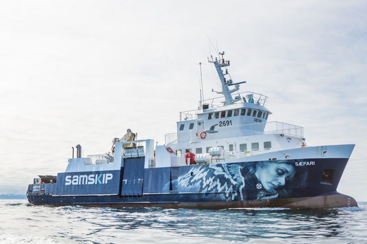 mural on the Sæfari ferry, Akureyri, Iceland by photorealistic artist Guido van Helten, created in collaboration with Selina Miles (2015). guidovanhelten.com
