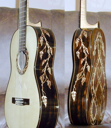 Tom Morello acoustic guitar. Bright top with intricate vine and leave engravings inlay on warm brown wood sides and back. RESEARCH #DdO:) - https://www.pinterest.com/DianaDeeOsborne/instruments-for-joy/ - INSTRUMENTS FOR JOY. He  played in the bands Audioslave and Rage Against the Machine. He performs as a solo acoustic artist under the pseudonym The Nightwatchman. Used electric guitars a lot also! Pinned from axewar via Koldo Rama.