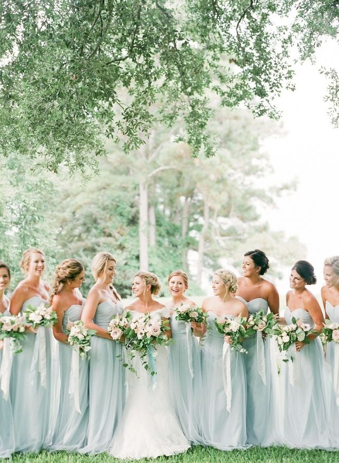 Pastel blue bridesmaids dresses: http://www.stylemepretty.com/north-carolina-weddings/2017/03/14/a-classic-southern-affair-that-totally-embraces-coastal-beauty/ Photography: Rach Loves Troy - http://rachlovestroy.com/