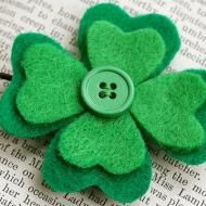 Felt shamrock pin. How to sew on a button - for Cloverbuds. Add a safety pin to the back to wear it. Could be used for the Cloverbud graduation ceremony.