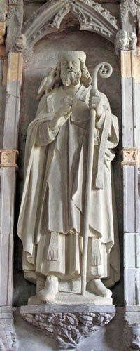 Nave stone carving of St David and his symbolic attribute, a dove, at St Davids Cathedral, Wales. (St David's Cathedral)