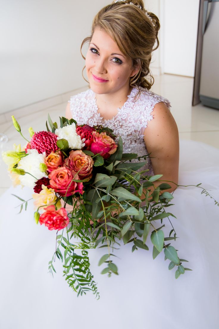 Free-form Bridal Bouquet by Pronkertjie {Gauteng, SA}. This specially created bouquet suits her so well. The bouquet includes Red Waratahs / Telopea's, Peach / Blush Lisianthus, Burgundy Carnations, Snowdon White Chrysanthenums, Crystal Leila Carnation and a combination of Pennygum, Pepper Tree Leaves & Viburnum. {Full album available at www.pronkertjie.co.za}