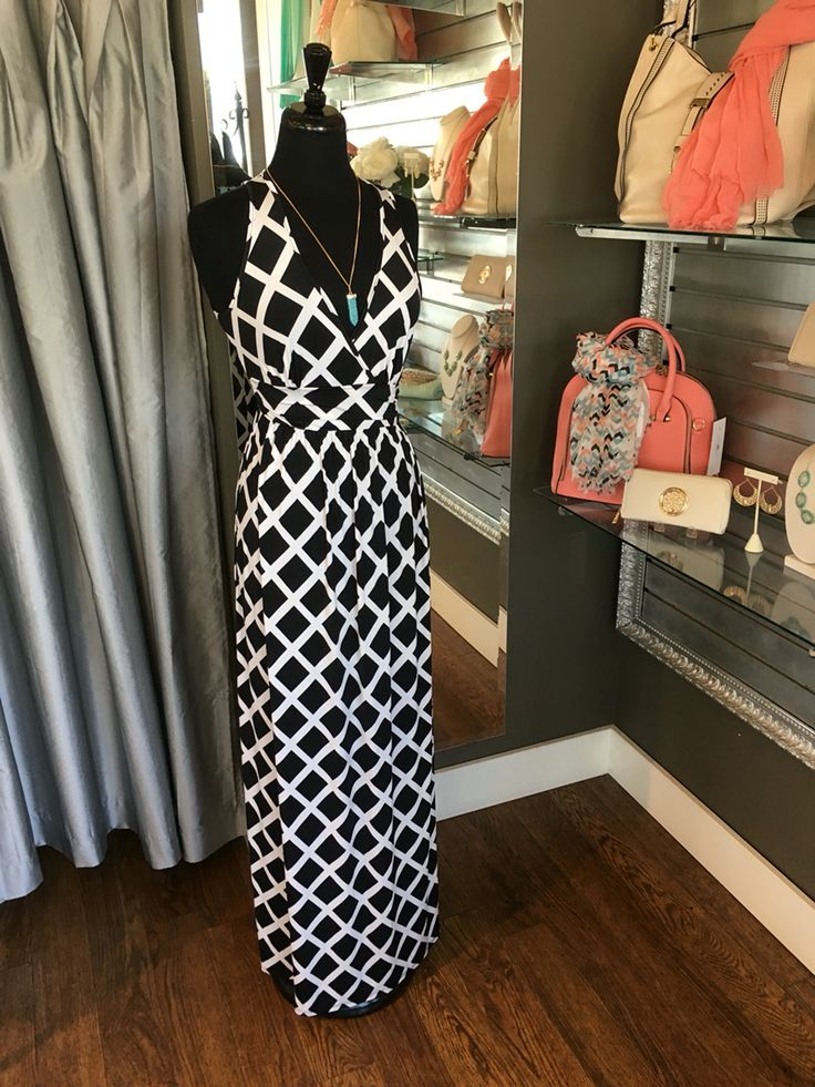 Black and White Criss-Cross Maxi Dress - The style of this dress is very flattering for many different body types. This dress is perfect to slip on for an summer date or an evening strolling through the market. (Black and White Criss-Cross Maxi Dress $72CAD) #summer #summerstyle #fashionista