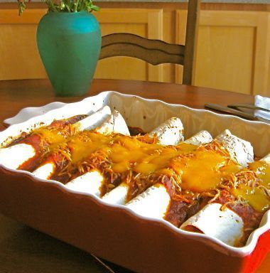 This chicken enchilada recipe is quick and easy. Made with rotisserie chicken, cream cheese, salsa, cheese and enchilada sauce, these easy chicken enchiladas are also a great make-ahead freezer recipe.
