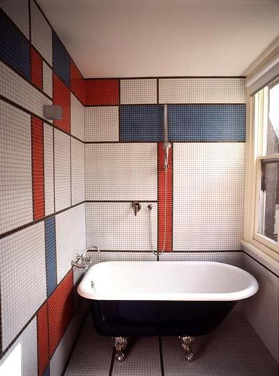 We love this bathroom inspired by Bauhaus. It works really well with the small mosaic like tiles.