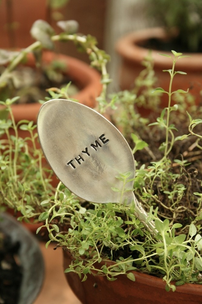 Flatten old spoons as plant markers