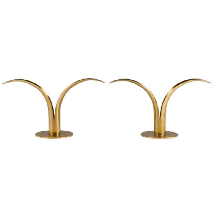 4.75 in.Hx8.75 in.Wx3.5 in.D NY Pair of Midcentury Brass Candleholders | From a unique collection of antique and modern candle holders at https://www.1stdibs.com/furniture/decorative-objects/candle-holders/