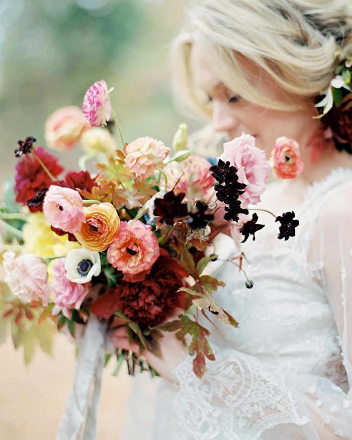 romantic fall bouquet featuring peonies, ranunculus and anemones with fall foliage by Bows + Arrows