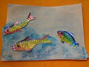 aluminum foil fish colored with markers and rubbed over a cheese grater for scale imprints