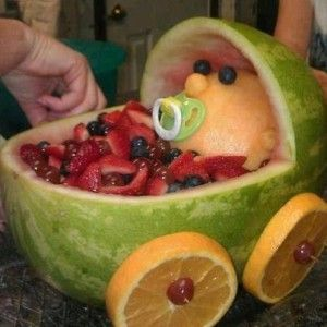 Great idea for a baby shower - fruit filled pram with babe!!