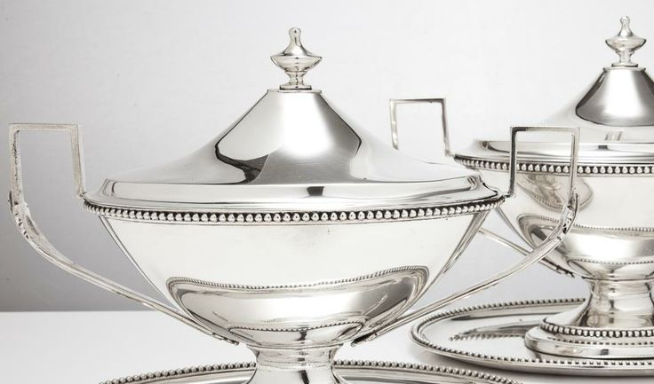Neo-classical was at its height from the late 1770s. These antique sterling silver neo-classical sauce boats on stands with unusual squared handles date from 1781, by William Holmes. www.silvervaultslondon.com