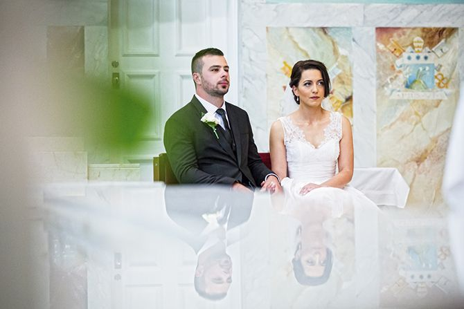 Beautiful ceremony shot, using reflection in the church #markjayphotography #sydneyweddingphotographer #weddingphotography #bride #groom #wedding
