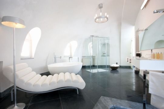 Superb floor lamp and recliner for a grand bathroom