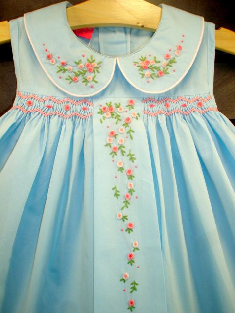 smocking on either side of embroidered panel down the front