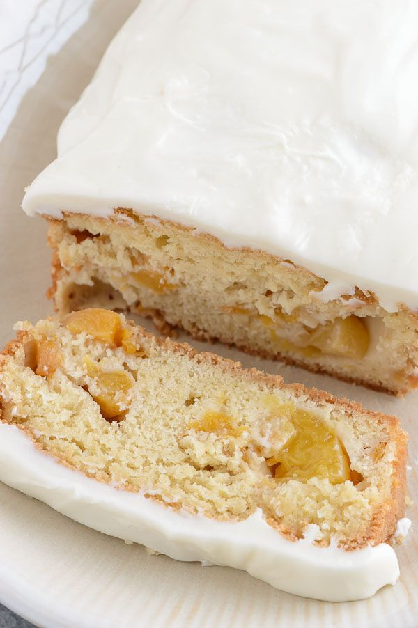 Peach Pound Cake with Cream Cheese Frosting - Sweetly delicious pound cake with juicy chunks of peaches and topped with silky cream cheese frosting.