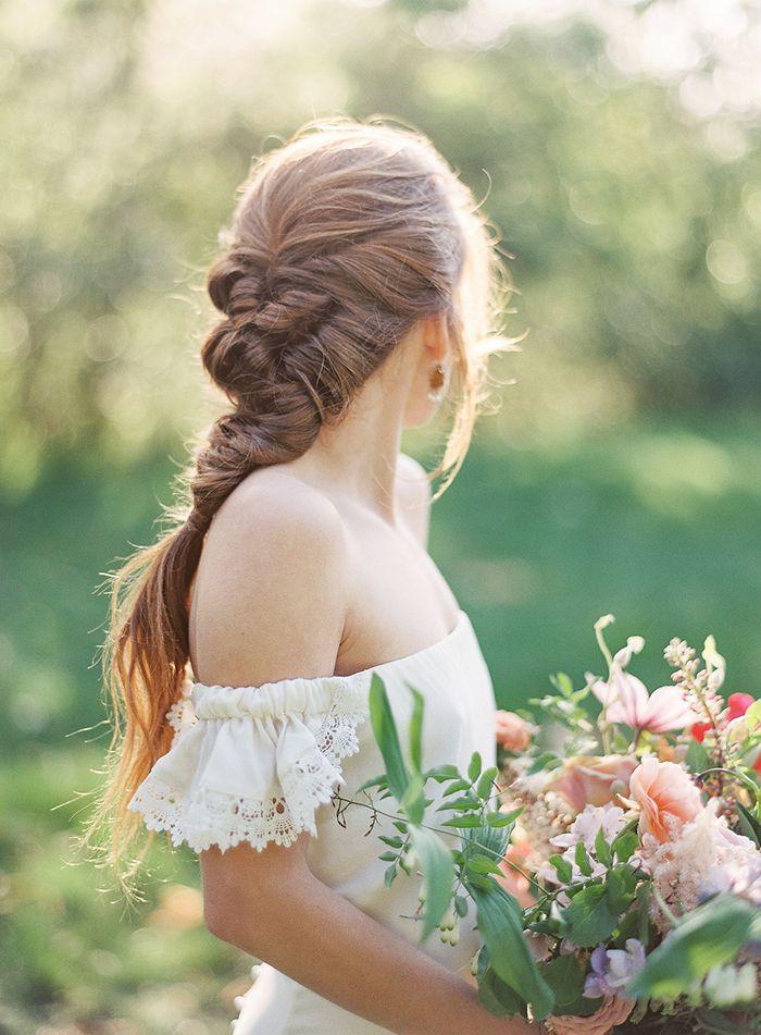 Loose Braided Bridal Hairstyle with an Off the Shoulder Wedding Dress    #wedding #weddingideas #californiawedding #filmphotography #filmweddingphotography #bouquet #bride #braids #weddinghair