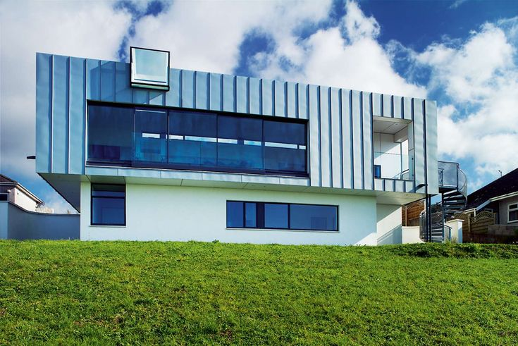 The zinc-cladding on this industrial-looking home in Plymouth protects the property from the marine air