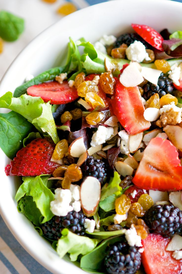 Springtime Mixed Berry Salad -Full of fresh berries, creamy feta, and nutty toasted almonds with an homemade balsamic vinaigrette. It makes for a perfect side to a meal or add some grilled chicken and you've got a quick, easy, and delicious main dish!