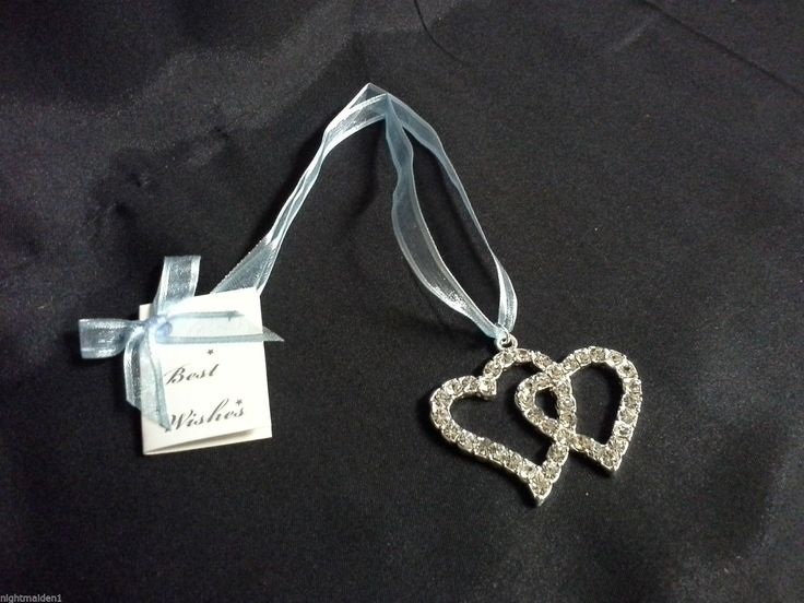 Silver double diamante heart on a blue ribbon with gift card.