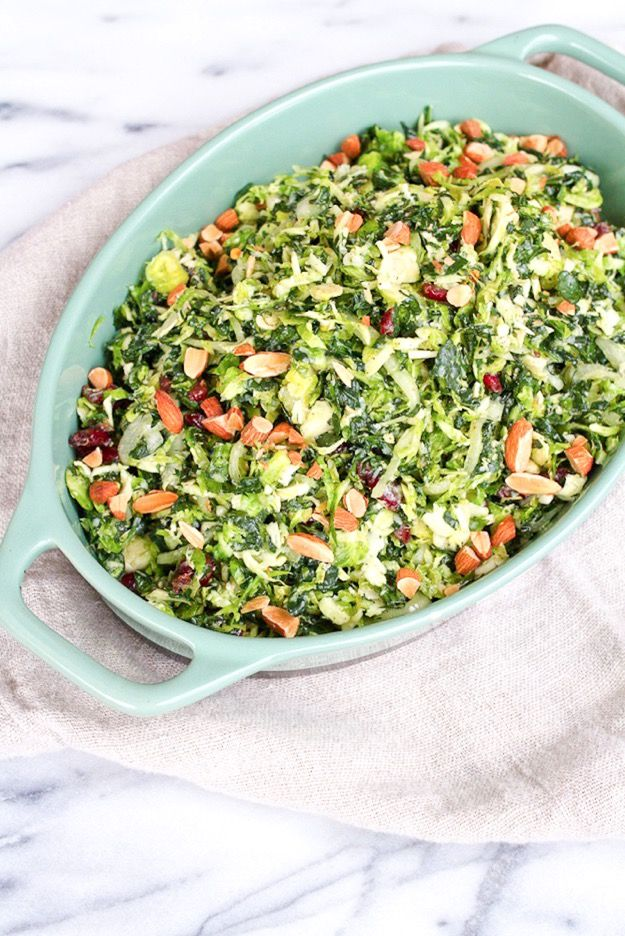 Salad done right    Kale and brussels sprout salad with cranberries, marinated onions, almonds and pecorino cheese.