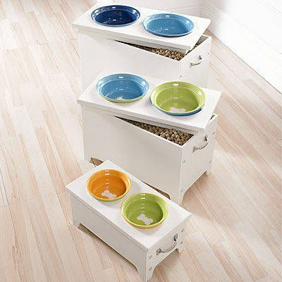 elevated dog bowls with storage for food. I can DIY this one