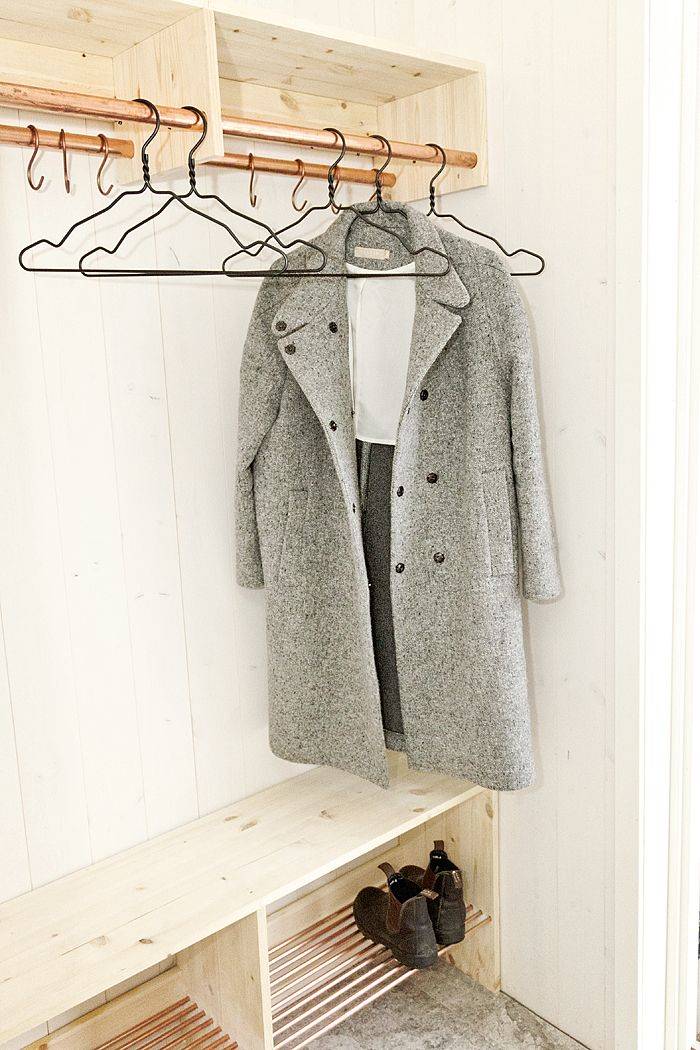 simple coat & shoe storage...shelf above enough room for boxes to store gloves & scarves etc