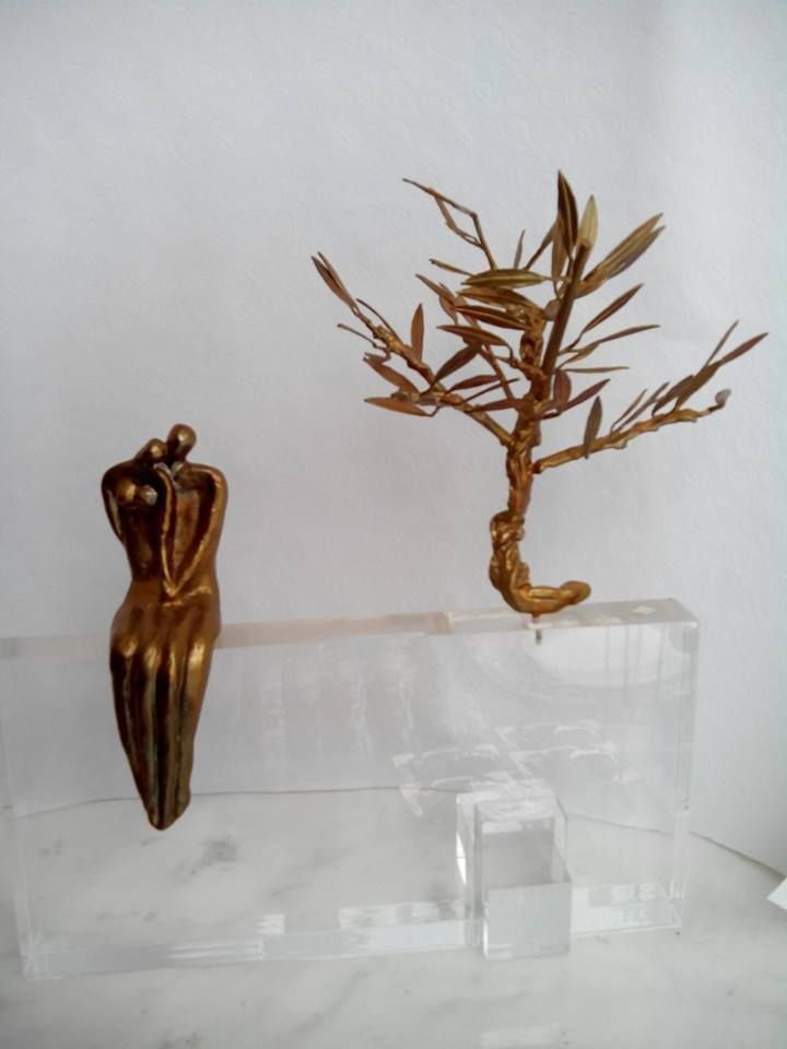 Couple under the olive tree. Casted bronze and perspex.