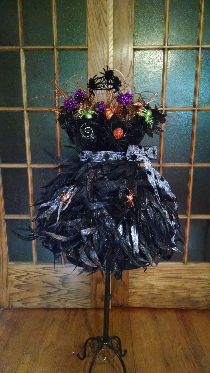A bewitching and elegant Halloween display using faux foliage and a wire dress forms. Click on the link for a tutorial to show you how to make this.