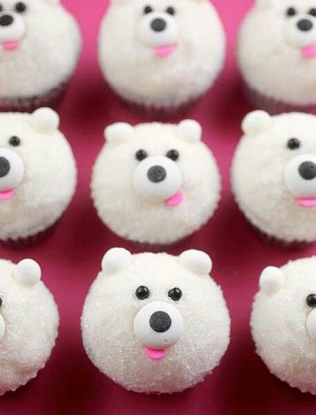 """Hahahahaha! Look at that one! They're bear cupcakes and I like them because they're on a towel that's pink."""