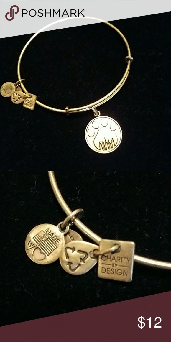 Paw print Alex & Ani gold bracelet PAW PRINT Alex & Ani gold bracelet.  Lightly worn but shows a little tarnish.  Smaller tags are difficult to buff out but otherwise is good condition Alex & Ani Jewelry Bracelets