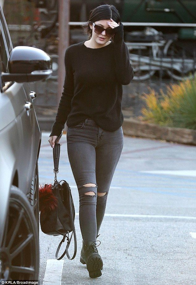 Low-key: Kylie wore a pair of ripped grey jeans and heavy-duty boots and appeared to go make-up free