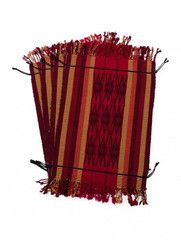 This Table Mat - Set of 4 by ExoticEcho carries designs that showcase patterns Inspired by the traditional textile culture of Nagaland tribes. All products are eco-friendly hand made products.  It speaks of its own unique style and will serve as a perfect addition to your collection of colorful home accents.