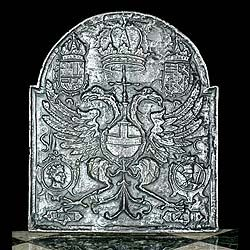 A WELL DEFINED CAST IRON FIRE BACK WITH DOUBLE HEADED EAGLE DECORATION. The symbolism is of the Byzantine, the first Christian Church, founded by the Roman Emperor Constantine in Constantinople, looking to East and West. Flemish 18th century.
