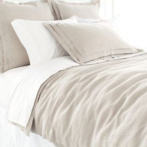 Subtle sophistication and beautiful detail join together on our neutral linen duvet cover. Hidden-button closure.