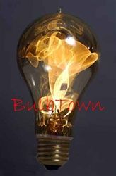 Lightbulb looks like a gaslight $16 For outside lamp post. I am in love with this bulb! It's so cool!