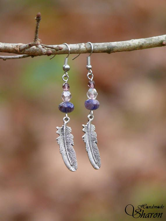 Long purple feather earrings with glass beads