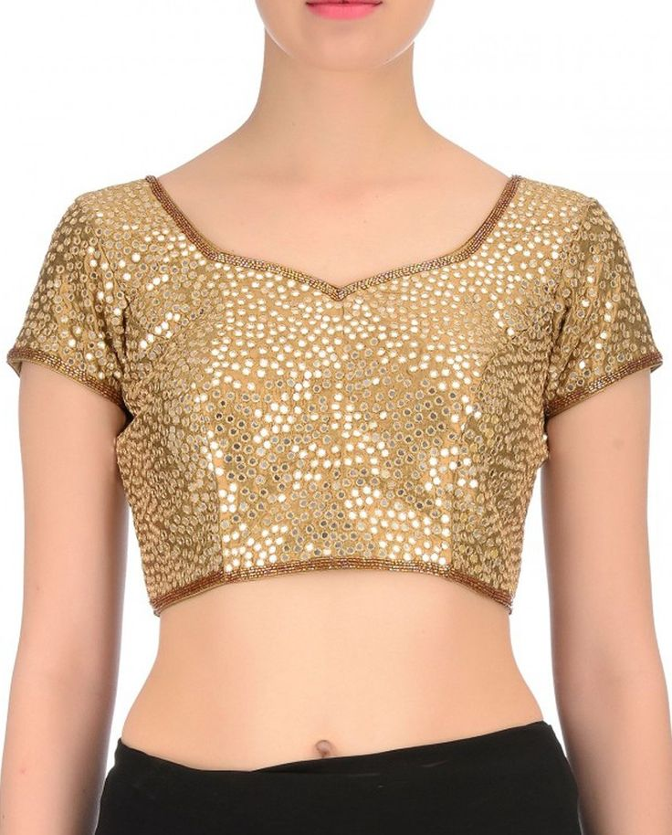 All over small mirror embroidered Copper blouse   All over small mirror embroidered Copper blouse Triangle pattern brocade blouse with elegant lace, highlighted with piping and pearl lace It is a standard sized blouse and can be customizes by the patron from 32-44 bust size